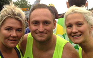 Three charity runners smiling for the camera