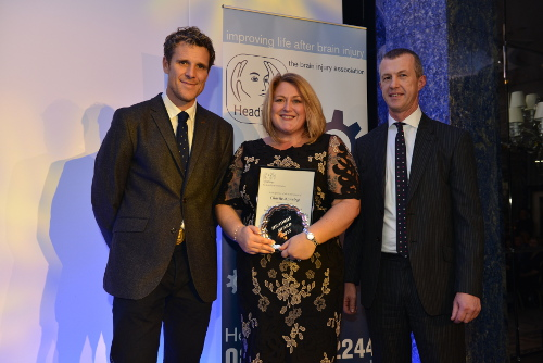 Charlie collects her Carer of the Year Award in 2015