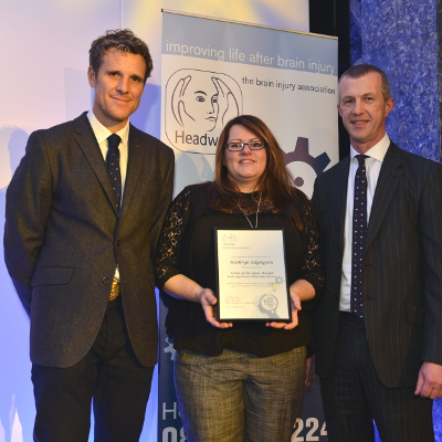 Kathryn collects her Headway Carer of the Year Award