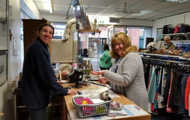 Jackie Alton serving a customer at Headway Eastwood shop