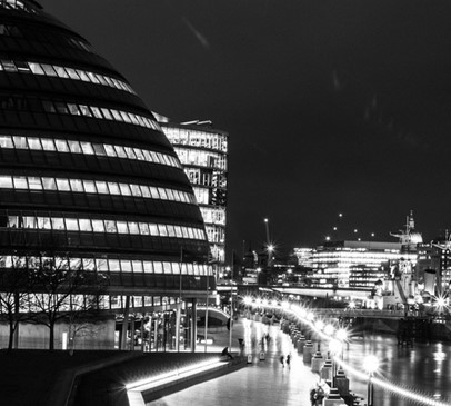 Nightime image of London's City Hall and the River Thames